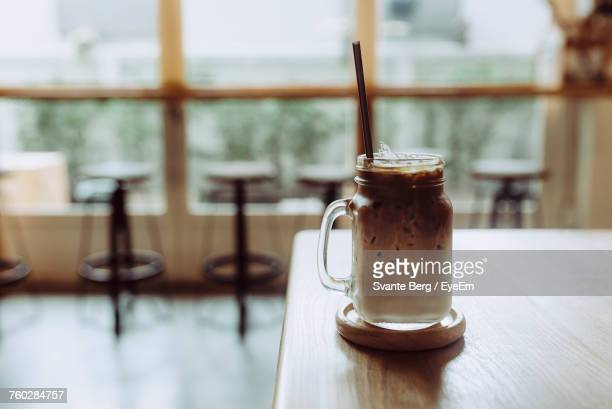 Iced Coffee In Jar On Table At Restaurant