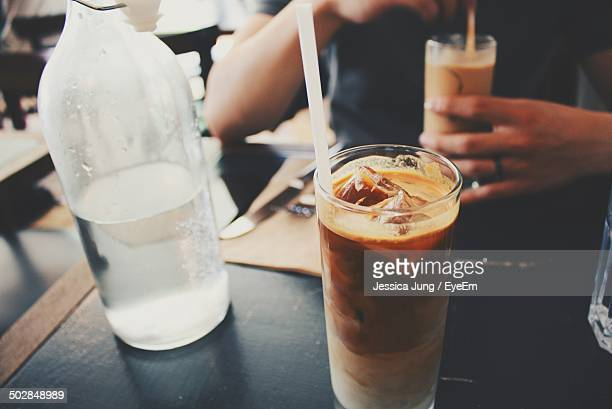 Iced coffee on cafe table