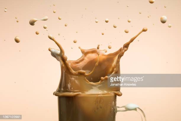 iced coffee splashing - caffeine stock pictures, royalty-free photos & images