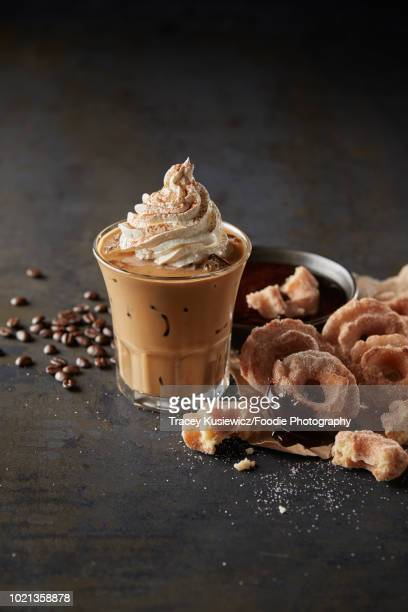 iced coffee topped with whipped cream and donuts - dessert topping stock pictures, royalty-free photos & images