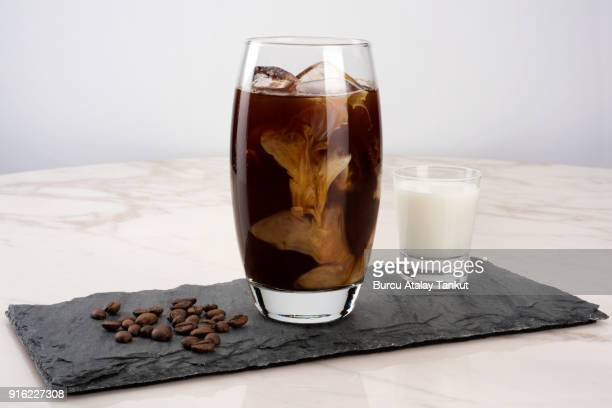 iced coffee with milk - iced coffee stock pictures, royalty-free photos & images