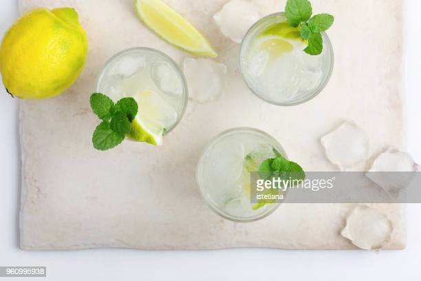 iced cold lemonade with fresh lemon juice - tonic water stock pictures, royalty-free photos & images