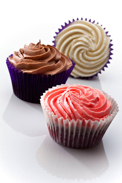 Iced cupcakes on a white background