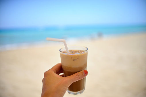 iced latte at the beach - gettyimageskorea