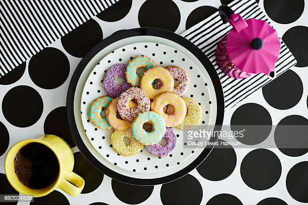 Iced ring biscuits and mug of coffee