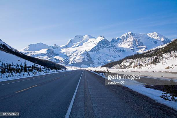 Icefields Parkway leading up to snow covered mountains