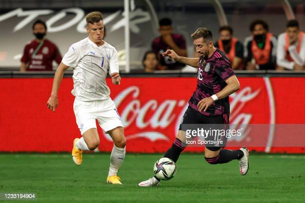 Iceland Andri Fannar Baldursson and Mexico Hector Herrera chase the ball during the game between Mexico and Iceland on May 29, 2021 at AT&T Stadium...