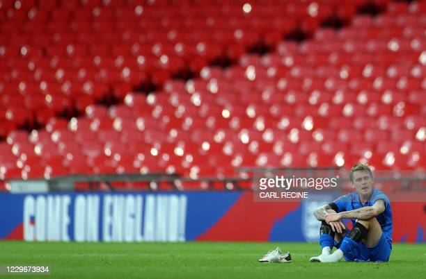 Iceland defender Ari Skulason reacts after the UEFA Nations League group A2 football match between England and Iceland at Wembley stadium in north...