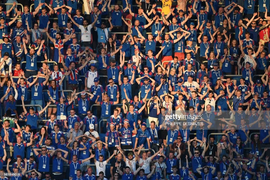 Iceland fans clap during the Russia 2018 World Cup Group D football match between Nigeria and Iceland at the Volgograd Arena in Volgograd on June 22, 2018. (Photo by Philippe DESMAZES / AFP) / RESTRICTED