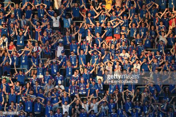 Iceland fans clap during the Russia 2018 World Cup Group D football match between Nigeria and Iceland at the Volgograd Arena in Volgograd on June 22...