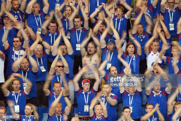 Iceland fans clap during the Russia 2018 World Cup Group D football match between Iceland and Croatia at the Rostov Arena in Rostov-On-Don on June...
