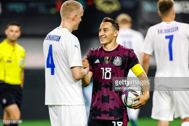Iceland Hjortur Hermannsson and Mexico Andres Guardado shake hands after the game between Mexico and Iceland on May 29, 2021 at AT&T Stadium in...