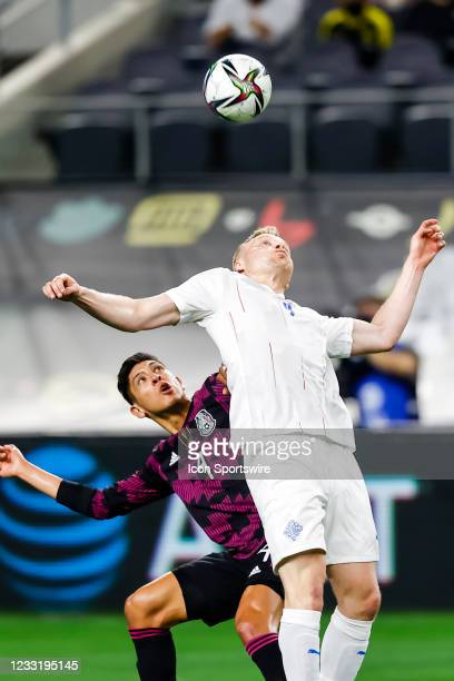 Iceland Hjortur Hermannsson and Mexico Edson Alvarez go for a header during the game between Mexico and Iceland on May 29, 2021 at AT&T Stadium in...