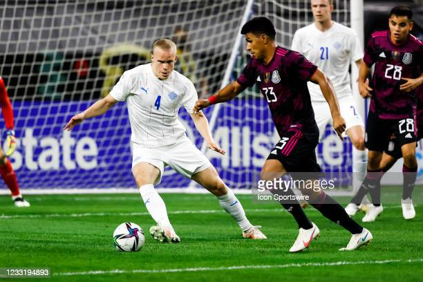 Iceland Hjortur Hermannsson and Mexico Jesus Gallardo battle for the ball during the game between Mexico and Iceland on May 29, 2021 at AT&T Stadium...