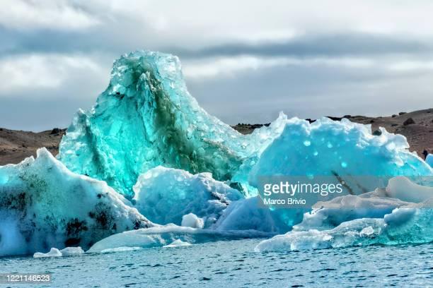 iceland. icebergs at jokulsarlon glacier lagoon - marco brivio stock pictures, royalty-free photos & images