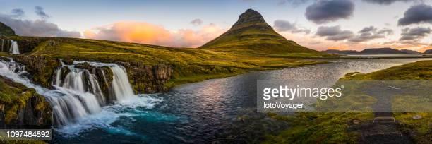 iceland iconic waterfalls river kirkjufell mountain peak panorama vesturland sunrise - idyllic stock pictures, royalty-free photos & images