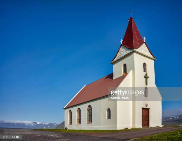iceland. ingjaldsholskirkja church in hellissandur. snaefellsness peninsula - marco brivio stock pictures, royalty-free photos & images