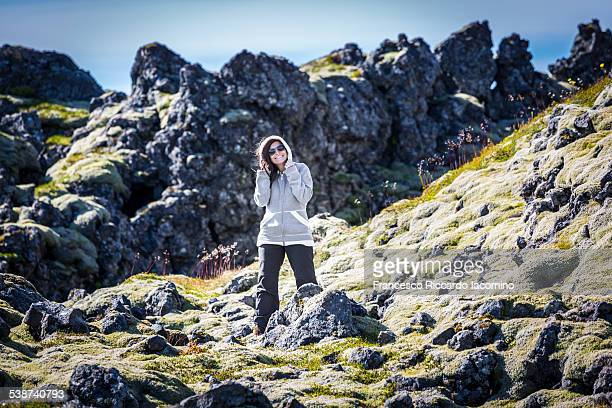 Iceland, landscape and girl having fun