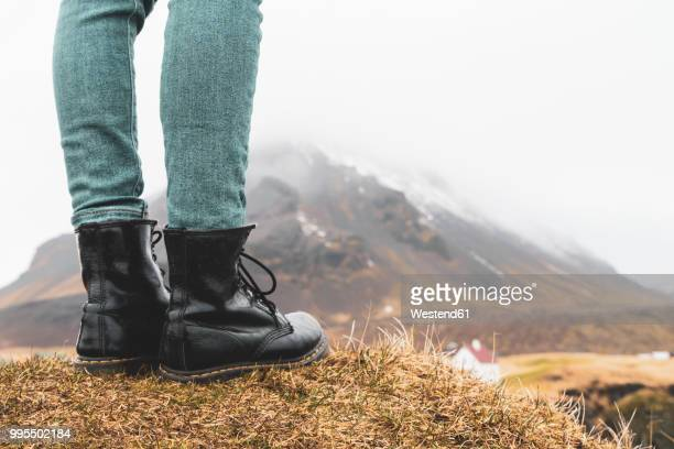 iceland, legs of woman standing on hill - boot stock pictures, royalty-free photos & images