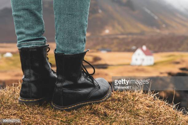iceland, legs of woman standing on hill - black boot stock pictures, royalty-free photos & images