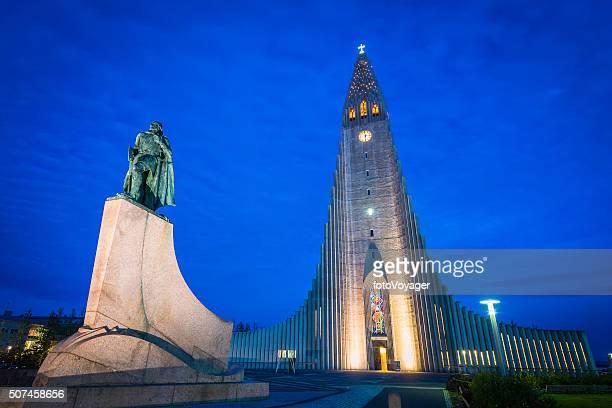 Iceland Leif Erikson statue illuminated in front of Reykjavik Hallgrimskirkja