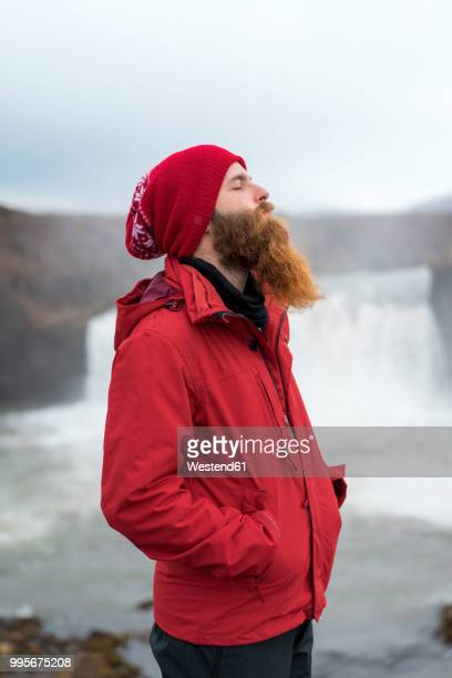 Iceland, North of Iceland, young man with closed eyes
