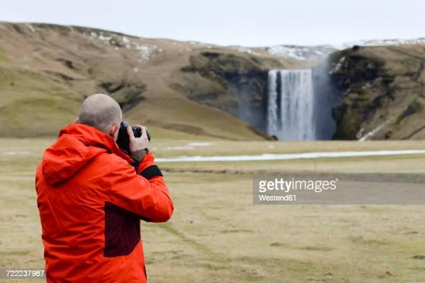 Iceland, photographer at Skogafoss waterfall