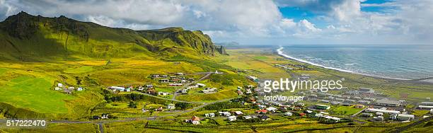 Iceland picturesque town of Vik between mountains and Arctic Ocean