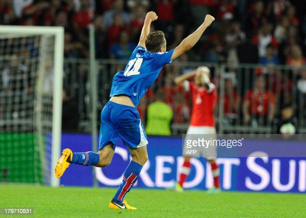 Iceland player Kari Arnason celebrates after teammate Johann Gudmunsson scores a fourth goal during the FIFA World Cup 2014 qualifying football match...