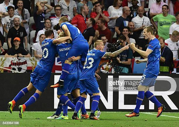 Iceland players celebrate scoring their second goal during Euro 2016 round of 16 football match between England and Iceland at the Allianz Riviera...