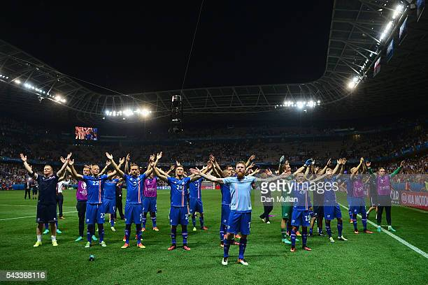 Iceland players celebrate their team's 21 win in the UEFA EURO 2016 round of 16 match between England and Iceland at Allianz Riviera Stadium on June...
