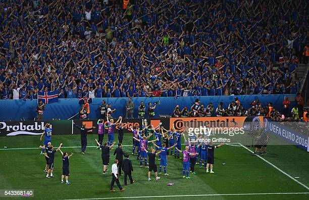 Iceland players celebrate their team's 21 win with their supporters after the UEFA EURO 2016 round of 16 match between England and Iceland at Allianz...