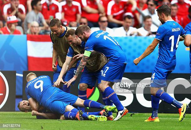 Iceland players celebrate their team's first goal scored by Jon Dadi Bodvarsson of Iceland during the UEFA EURO 2016 Group F match between Iceland...