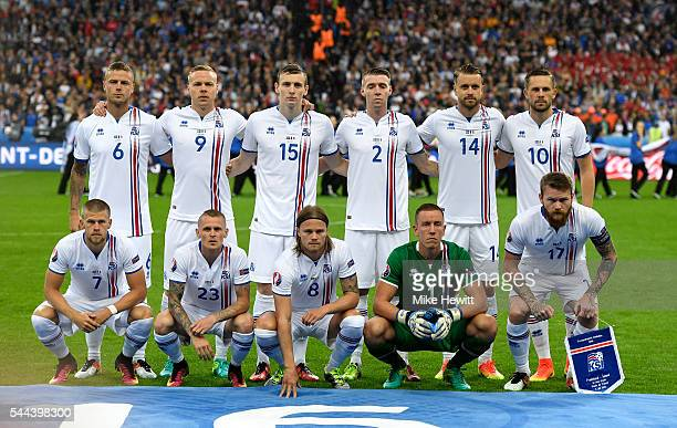 Iceland players line up for the team photos prior to the UEFA EURO 2016 quarter final match between France and Iceland at Stade de France on July 3...