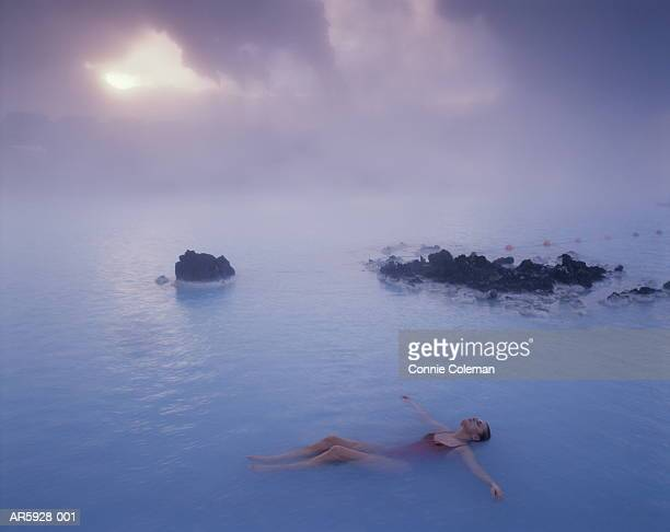 Iceland, Reykjanes Peninsula, Blue Lagoon,woman floating in hot spring