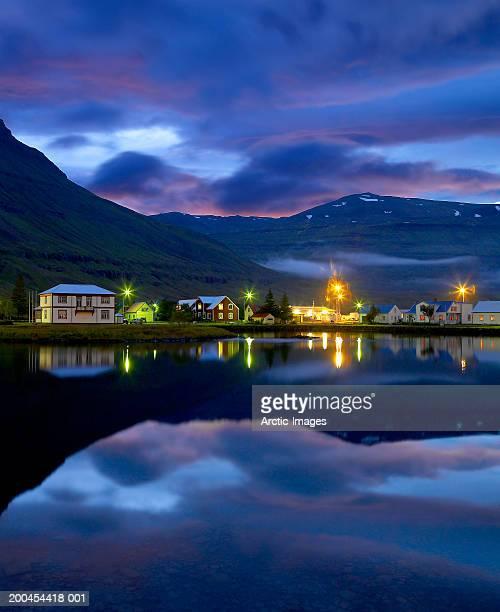Iceland, Seydisfjordur harbor and houses, dusk