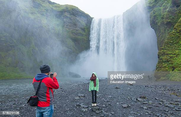 Iceland Skogafoss Waterfall famous falls in South Iceland at the Skoga River with tourists taking photos