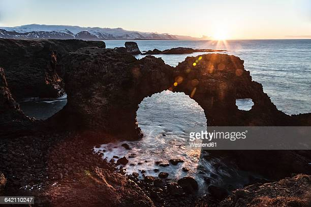 Iceland, Snaefells, Arnarstapi, view to natural arch at backlight