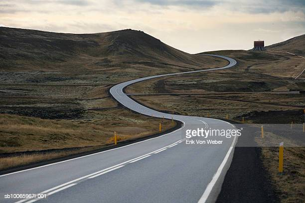 iceland, south bound road toward grindavik - winding road stock pictures, royalty-free photos & images