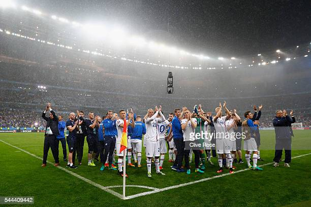 Iceland supporters applaud their supporters after the UEFA EURO 2016 quarter final match between France and Iceland at Stade de France on July 3 2016...