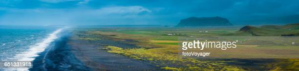 Iceland surf on black sand beach remote Arctic farms panorama