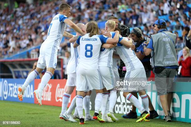 Iceland team celebrate their side's first goal scored by Alfred Finnbogason during the 2018 FIFA World Cup Russia group D match between Argentina and...