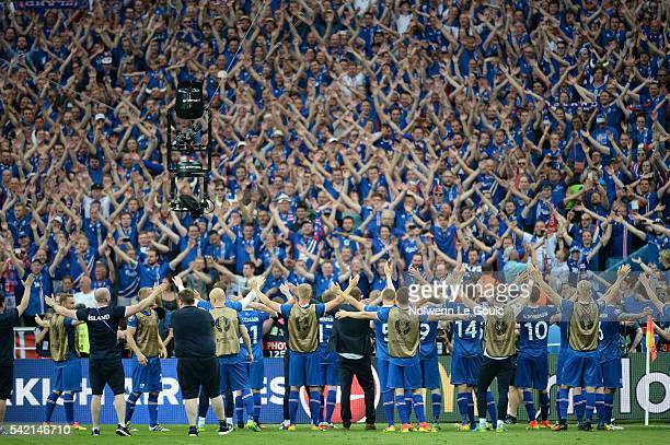 Iceland team celebrates qualification with fans during the UEFA EURO 2016 Group F match between Iceland and Austria at Stade de France on June 22...