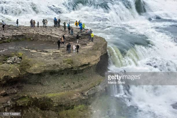 iceland. tourists approaching gullfoss 'golden falls' - marco brivio stock pictures, royalty-free photos & images