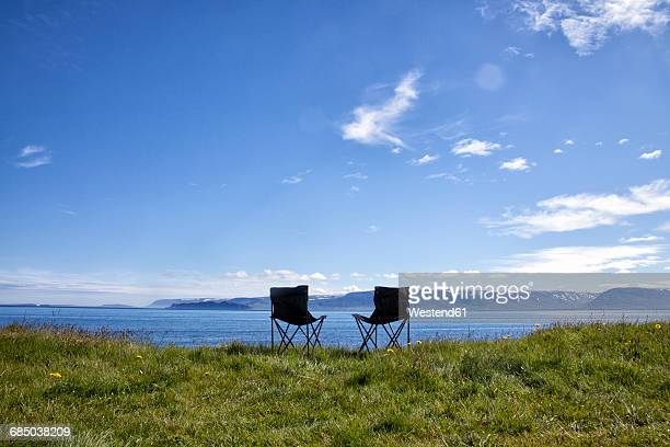Iceland, two camping chairs on a meadow