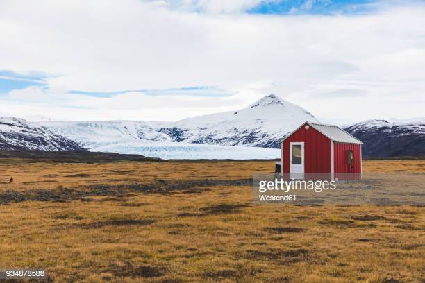 iceland, vik, barn in the countryside with glacier in background - shack stock pictures, royalty-free photos & images