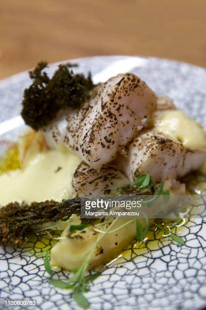 Icelandic baked cod served with mashed potatoes and vegetables