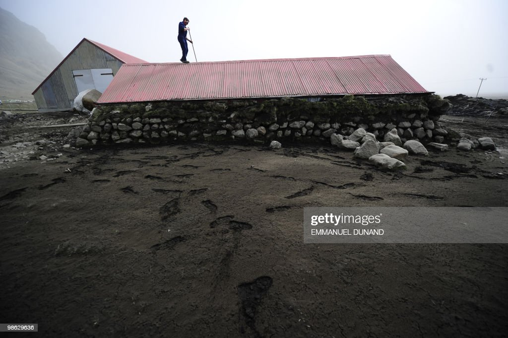 Icelandic farmers clear ash from a goat house after heavy ash fall hit their farm bellowing from the Eyjafjallajokull volcano in Steinar, Iceland, on April 20, 2010. New spurts of ash from Iceland's volcano triggered fresh travel mayhem today, puncturing stranded travellers' hopes of getting home despite the reopening of some of Europe's major air hubs. AFP PHOTO/Emmanuel Dunand