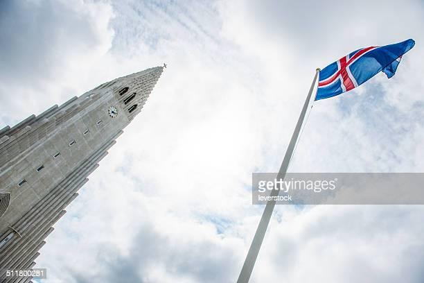 Icelandic flag flying and Hallgrimskirkja church