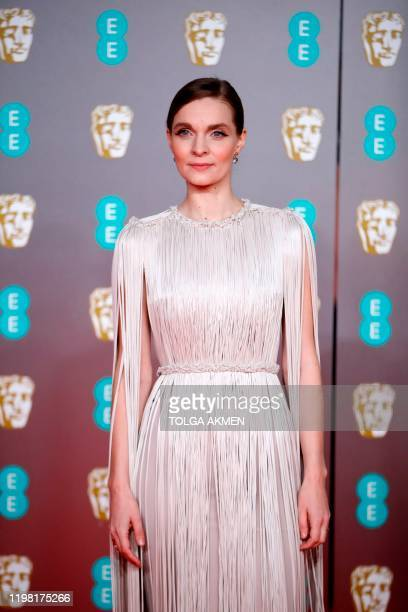 Icelandic musician Hildur Gudnadottir poses on the red carpet upon arrival at the BAFTA British Academy Film Awards at the Royal Albert Hall in...